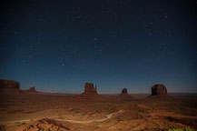 "Monument Valley Under the Stars Still no LakeshoreImages website so I may start adding more photos here.  I did get up to the Monument Valley Overlook/Parking Lot a little after dusk.  I took a series of photos, most at ISO 1600, f:2.8 & 8 to 15 seconds.  There was enough moonlight to show the formations, yet allowed enough of the stars to show to make it interesting.  It would have been better if there was a power blackout - the parking lot has lots of lights.  There are a few images with lights from returning cars, and airplanes, but overall it worked OK.  I washed the trailer & RAV4 on the way out of Gouldings Camp Park.  The water spray didn't remove everything; the bugs need an actual scrubbing, but at least the first layer of red dust is gone.  It was a short drive to Blanding, UT & the Blue Mountain RV Park.  I'm in site 8, a shaded back in that just fits the trailer & RAV4. After setting up I plan to drive out to the location for the trail to House on Fire.  It is too late in the day to properly photograph it - I'll do that tomorrow.  I did drive out to the trail head, and also stopped at the ""Official"" Mule Canyon Ruin Exhibit, about 1/2 mile west of Arch Canyon road, the entrance to the trail head. Laurent Martres, who's 3 books ""Photographing the Southwest"" have been my guide to many locations feels that the exhibit was built to keep down traffic in the canyon.  I'll have to agree with him - it is far to new looking to be realistic.   Mule Canyon Ruin Exhibit    Mule Canyon Ruin Exhibit After that it was back to the campground by way of the local grocery store & some barbecued chicken for dinner.  Until Tomorrow - Monument Valley"